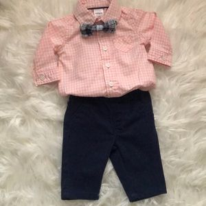 Carter's newborn outfit with a removable bow tie